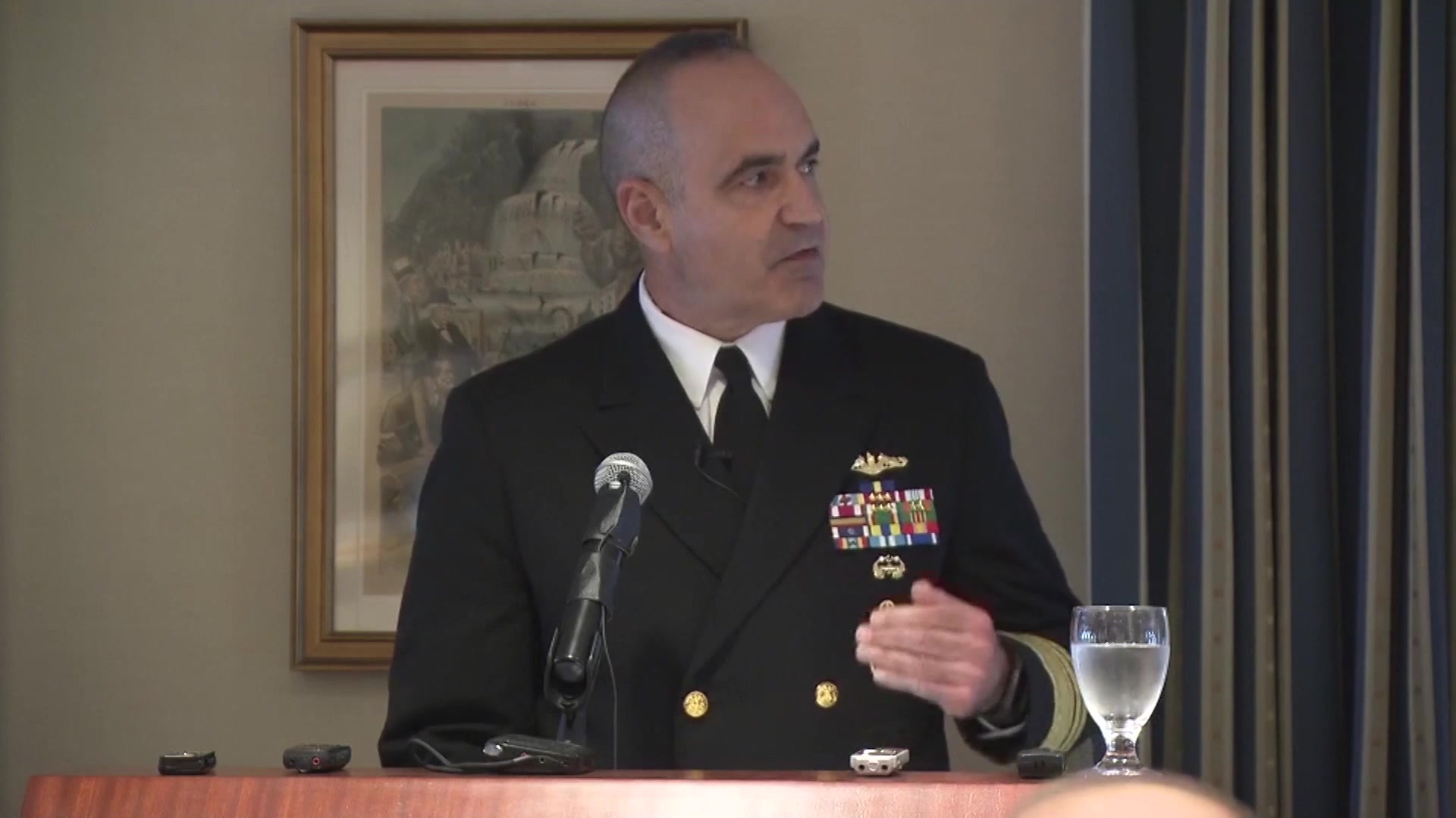 The deputy commander of U.S. Strategic Command delivers remarks from a lectern at a conference.