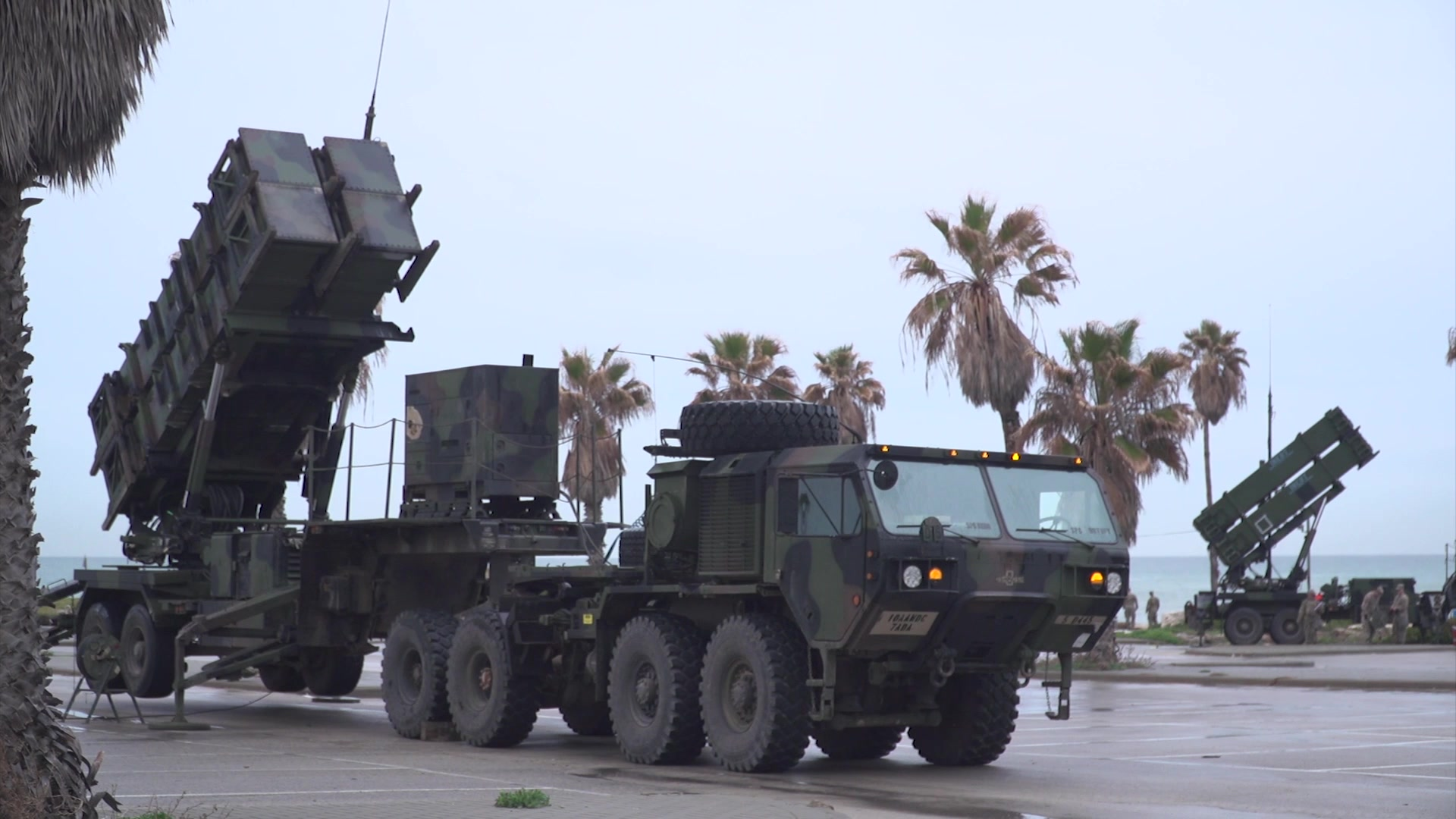 A vehicle transports a missile defense system.