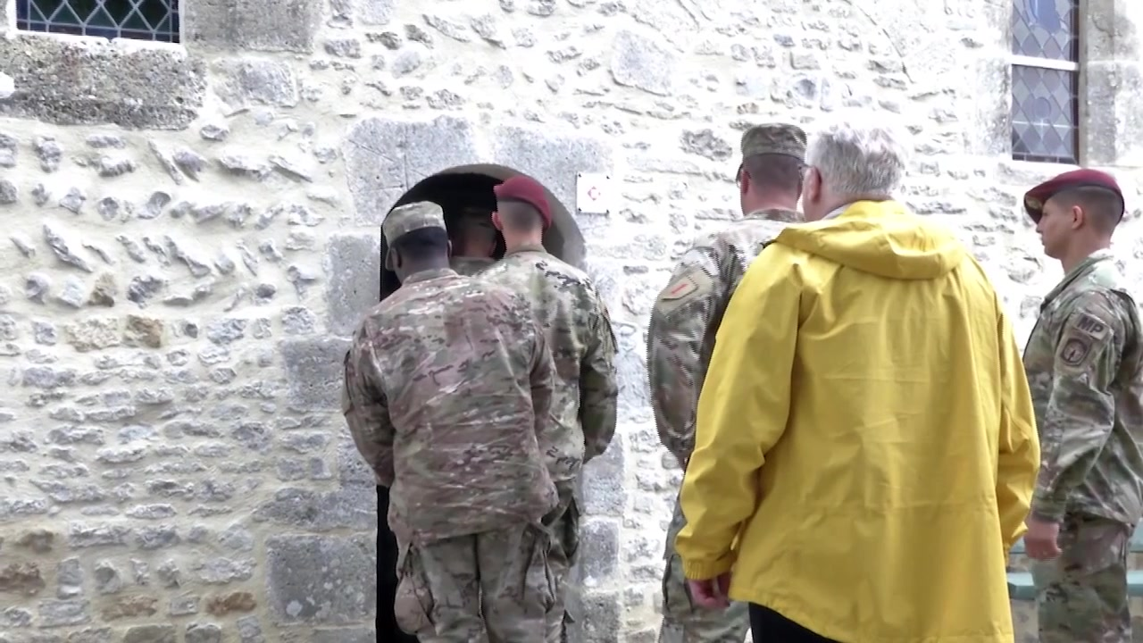 Soldiers visit an old stone church in France and discuss the experience.