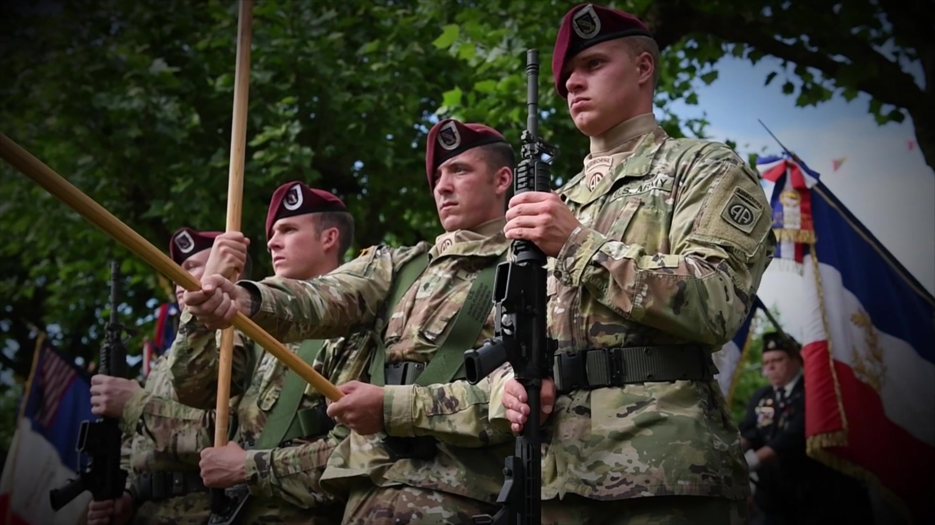 Soldiers attend an outdoor memorial ceremony.