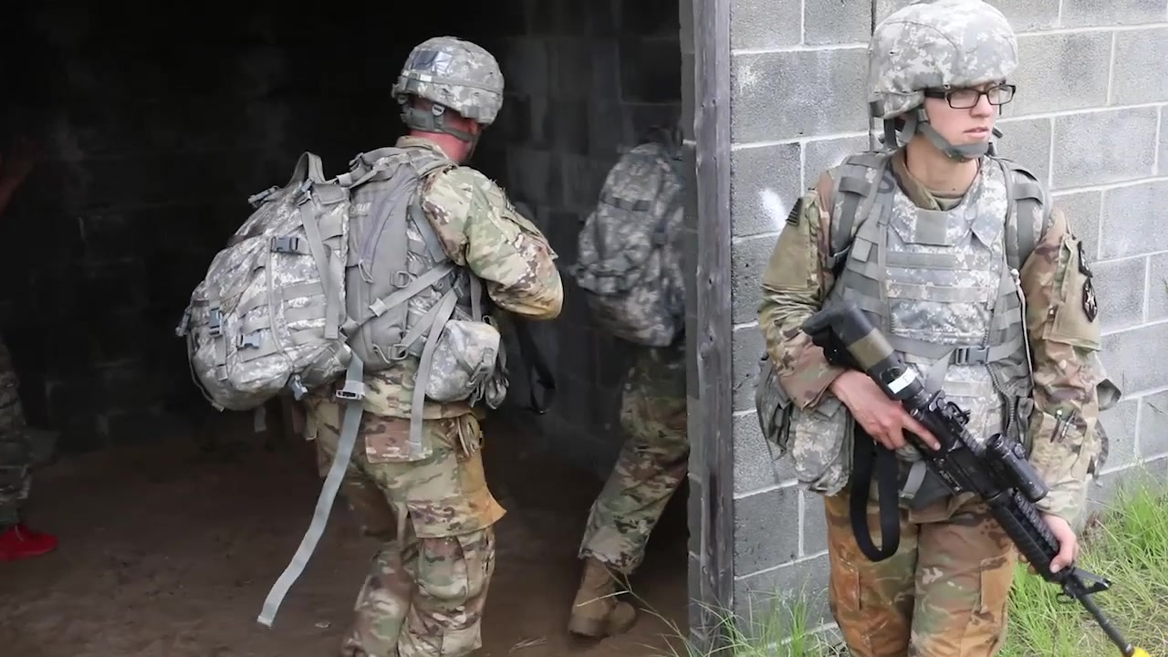 U.S. Army Reserve Soldiers conduct the urban live fire event of the 2018 U.S. Army Reserve Best Warrior Competition. The teams were comprised of junior enlisted Soldiers and noncommissioned officers going through the city clearing buildings. The objective was to find a U.S. Soldier who was a prisoner of war. (US Army Reserve Video by Spc. Joshua Talley)