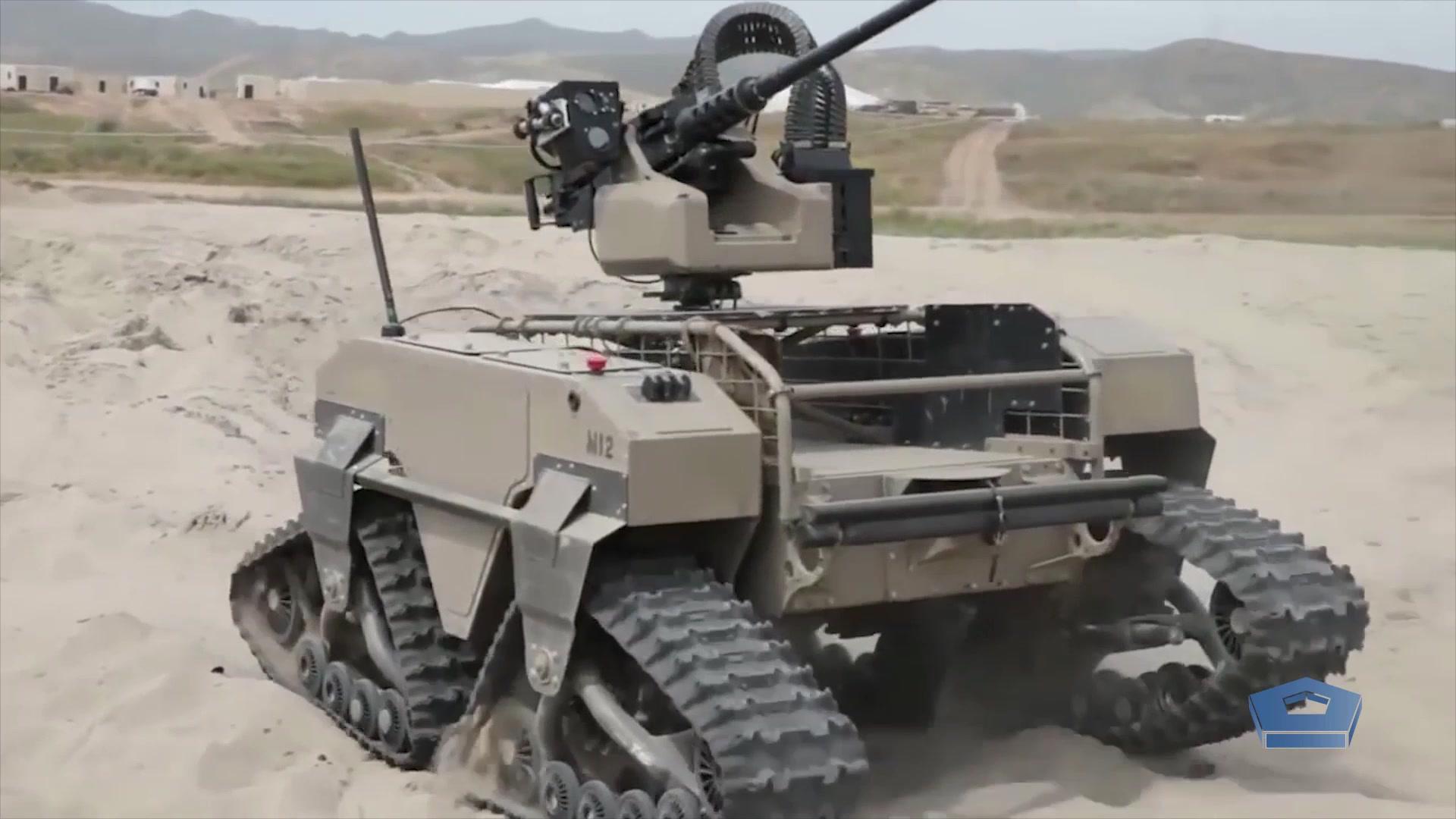 A futuristic tank sits on some sand.