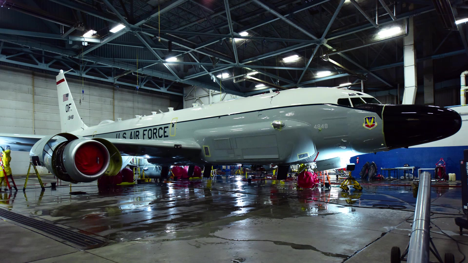 Airmen from the 55th Maintenance Group wash an RC-135 Rivet Joint Oct. 12, 2018, at Offutt Air Force Base, Nebraska. The Rivet Joint supports theater and national level consumers with near real time on-scene intelligence collection, analysis and dissemination capabilities. (U.S. Air Force video by Senior Airman Jacob Skovo) (This video's frame rate has been slowed from its original speed for flexibility in future products)