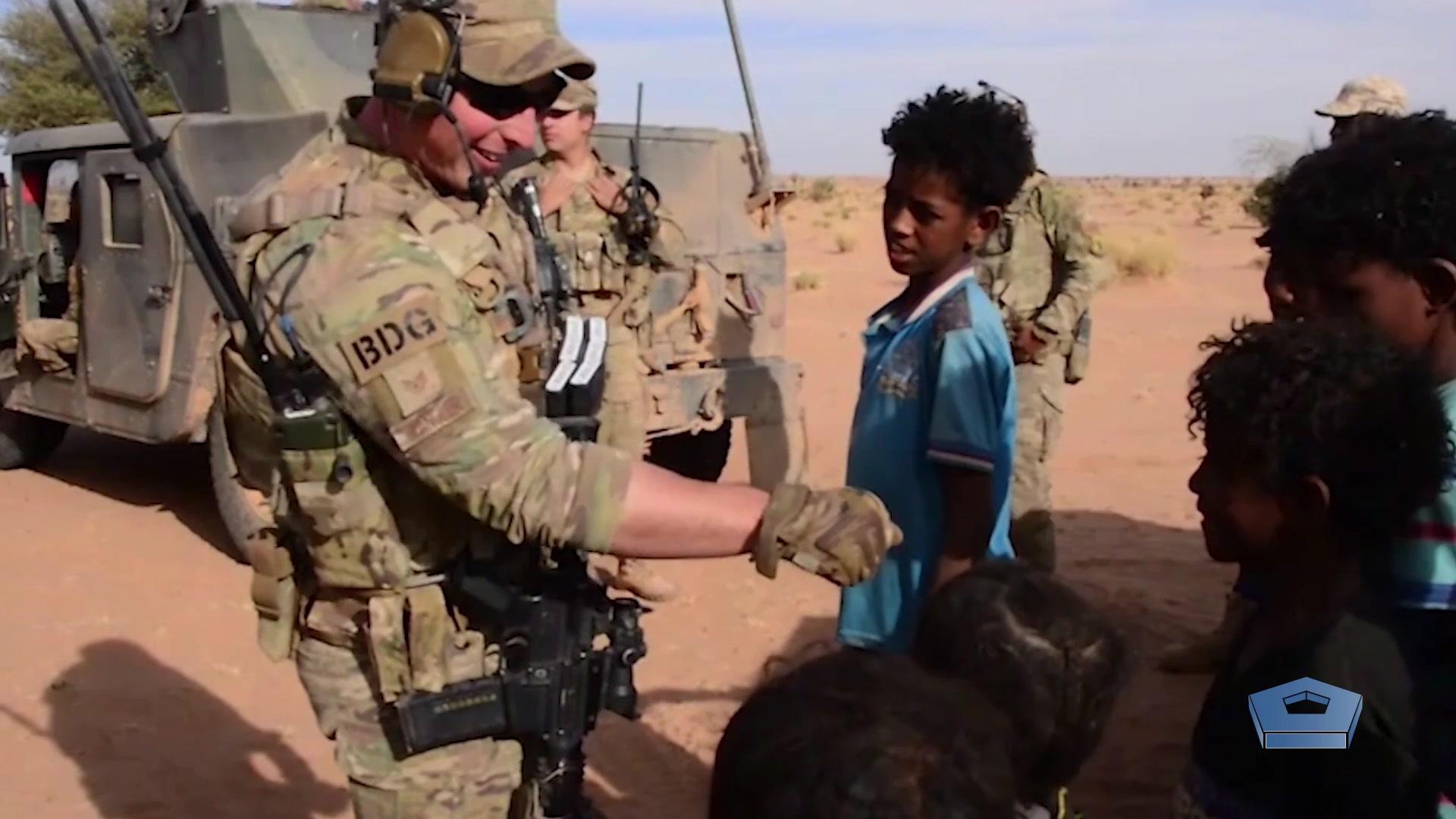 An Airman greets a civilian.