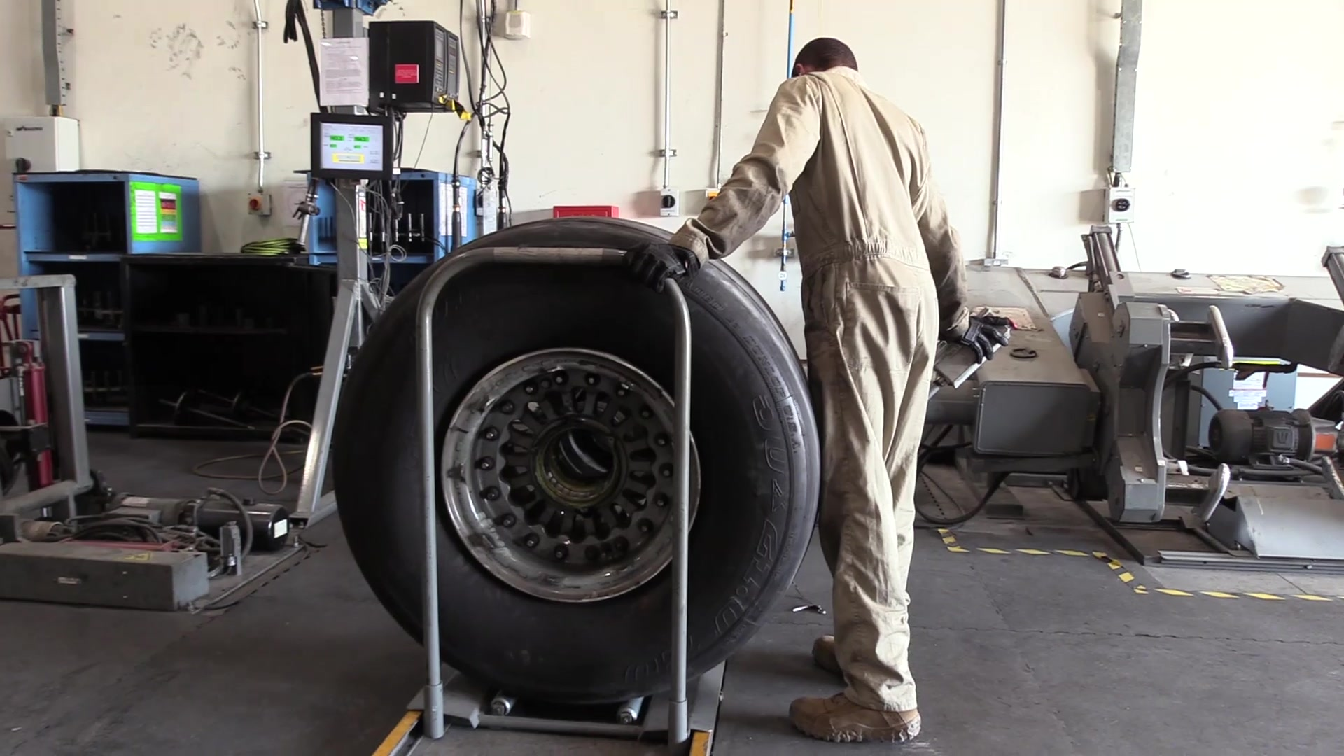 """Airmen from Al Udeid's 379th EMXS Wheel and Tire shop work """"tirelessly"""" to keep keep the mission rolling."""