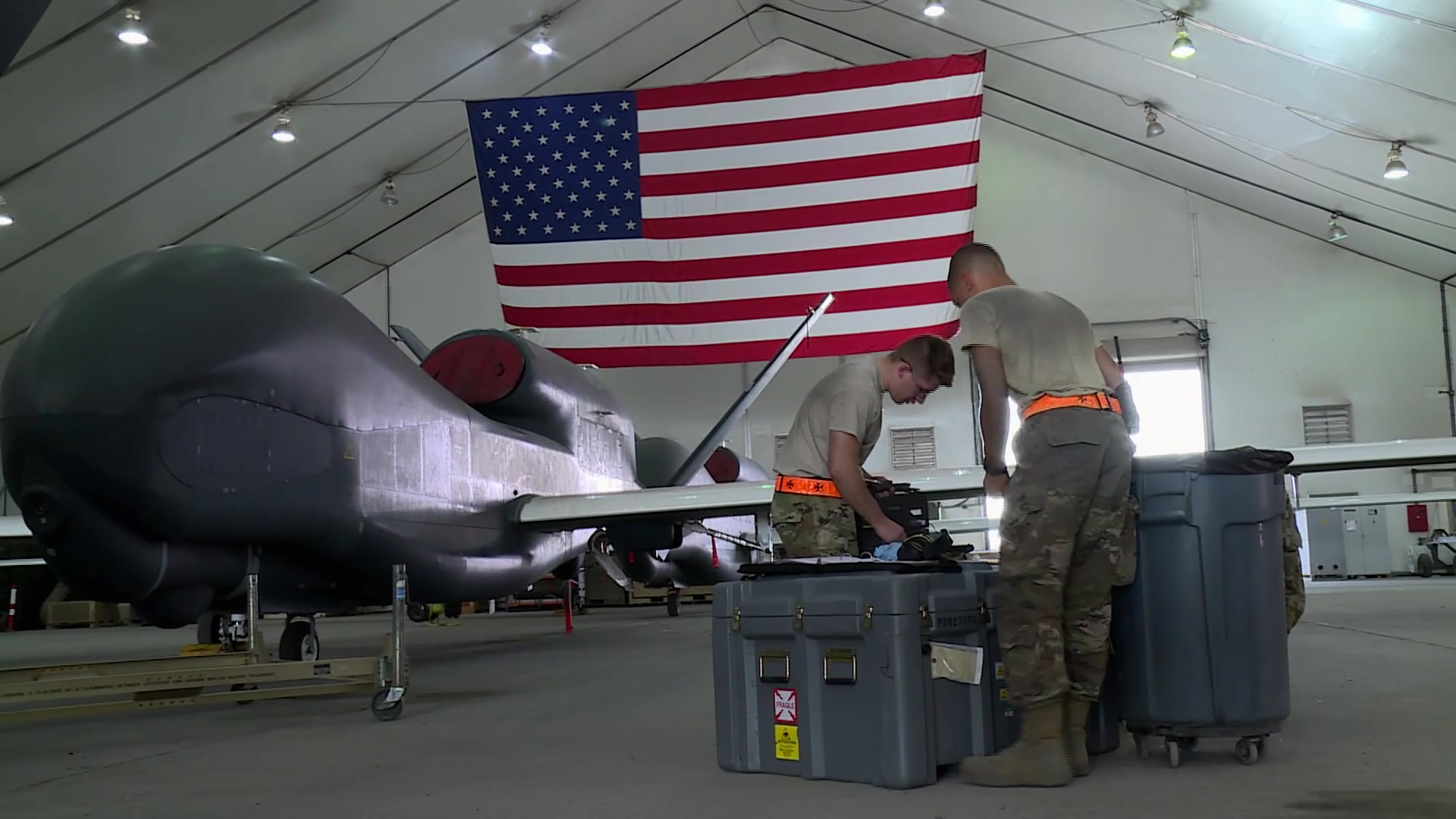 An RQ-4 Global Hawk pilot from the 99th Expeditionary Reconnaissance Squadron and a Crew Chief from the 380th Hawk Aircraft Maintenance Unit, share what they do for the mission every day, here at Al Dhafra Air Base, UAE.