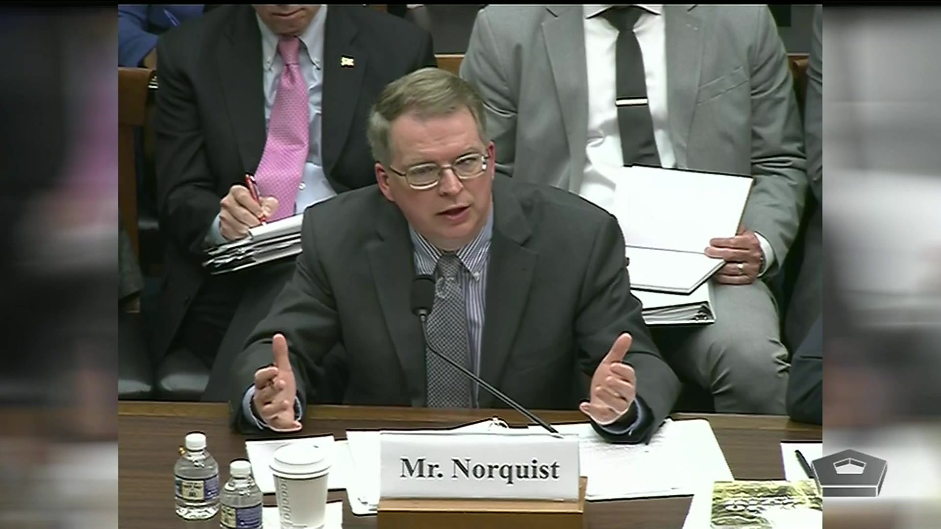 David L. Norquist speaks at a table.