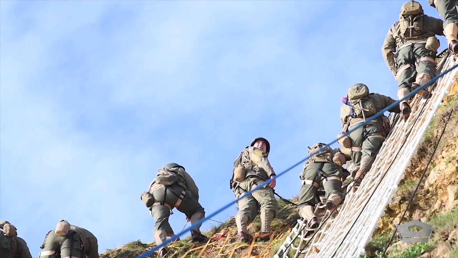 U.S. Army Rangers assigned to the 75th Ranger Regiment climb the cliffs at Pointe du Hoc in Cricqueville en Bessin, France, June 4, 2019. Rangers scaled the cliff to honor the 135 men killed or wounded from the 2nd and 5th Ranger Battalions while capturing and holding Pointe du Hoc. More than 1,300 U.S. service members, partnered with 950 troops from across Europe and Canada, converged in northwestern France to commemorate the 75th anniversary of Operation Overlord, the World War II Allied invasion of Normandy, commonly known as D-Day.  Video by Navy Petty Officer 2nd Class Robert Baldock, AFN Europe