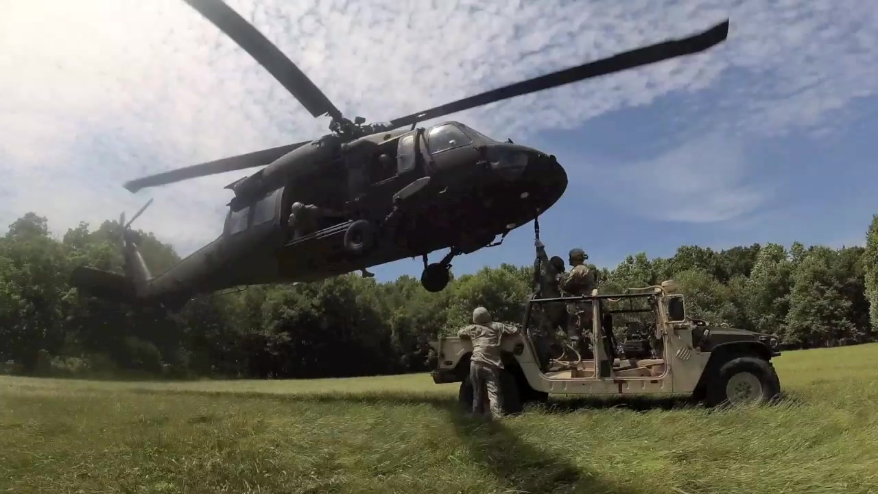 U.S. Soldiers with Alpha Company, 628th Aviation Support Battalion, 28th Expeditionary Combat Aviation Brigade sling load a Humvee to a UH-60 Black Hawk helicopter at Fort Indiantown Gap, June 12, 2019. The Humvee was flown to Schuylkill County Joe Zerbey Airport and driven back to Fort Indiantown Gap.