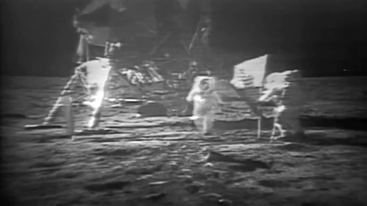 Astronauts walk on the moon during the Apollo 11 mission