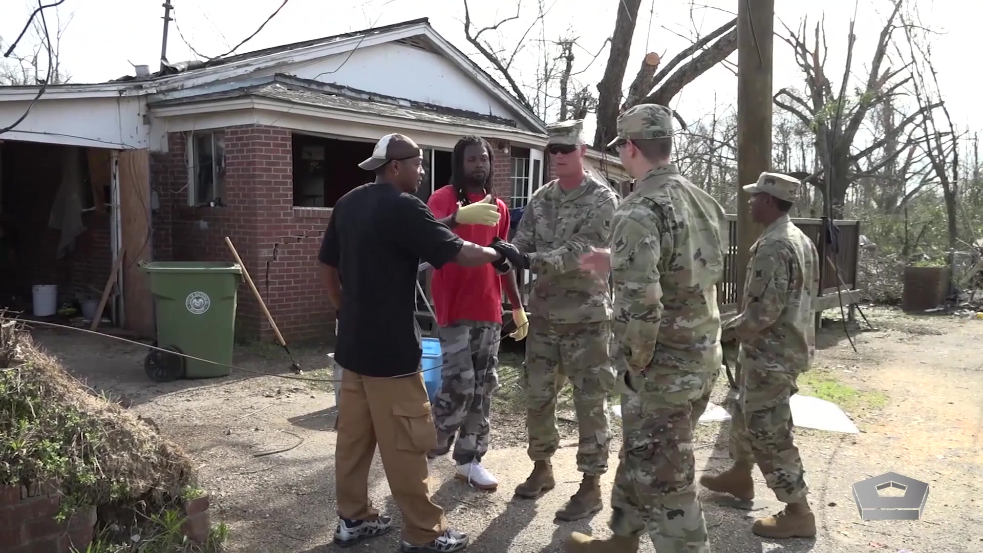 National Guard troops talk to victims of a natural disaster.