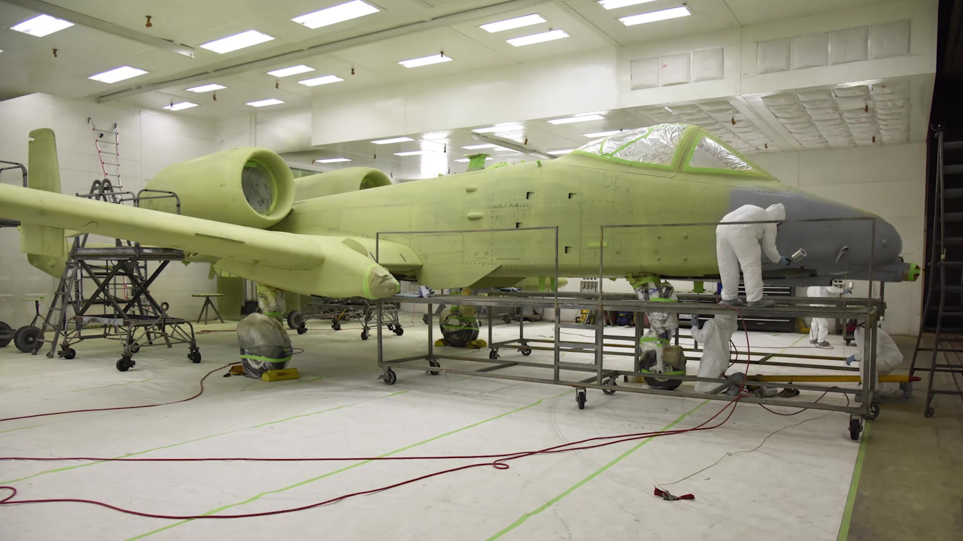355th Equipment Maintenance Squadron Airmen give an A-10 Thunderbolt II, assigned to the A-10 Demonstration Team, a custom paint job resembling a P-51 Mustang.