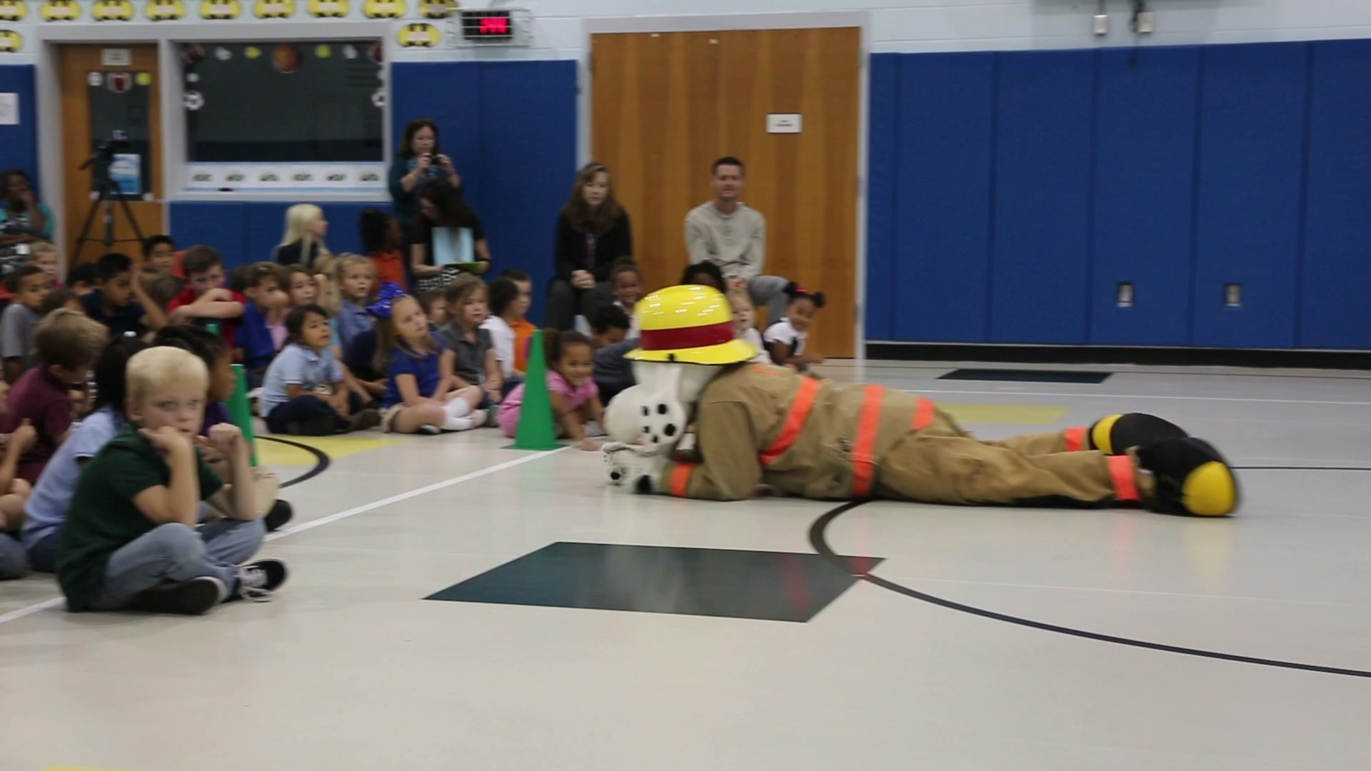 Firefighters and their mascot Sparky dance during a fire prevention training event at DeLalio Elementary School on Marine Corps Air Station New River, North Carolina, Oct. 21, 2019. The event is held annually at schools and Child Development Centers on Marine Corps Base Camp Lejeune and MCAS New River to promote education on fire safety. (U.S. Marine Corps video by Lance Cpl. Katie Campbell)