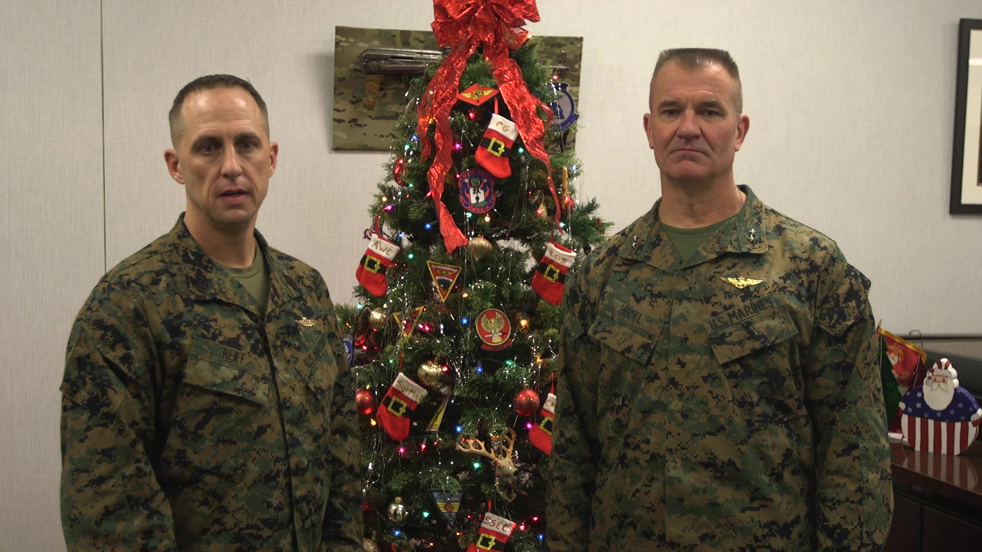 Marine Maj. Gen. Karsten S. Heckl, the 2nd Marine Aircraft Wing commanding general, and Sgt. Maj. Jacob Reiff, the 2nd Marine Aircraft Wing sergeant major, pose for Christmas video at at Marine Corps Air Station Cherry Point, North Carolina, Dec. 13, 2019. The video encourages Marines, Sailors and their families to take time to recharge and be safe this holiday season. (U.S. Marine Corps video by Cpl. Paige C. Stade)