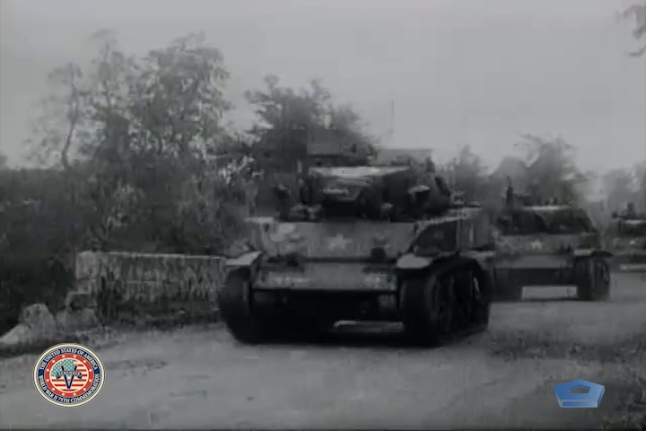 Tanks drive on a road.