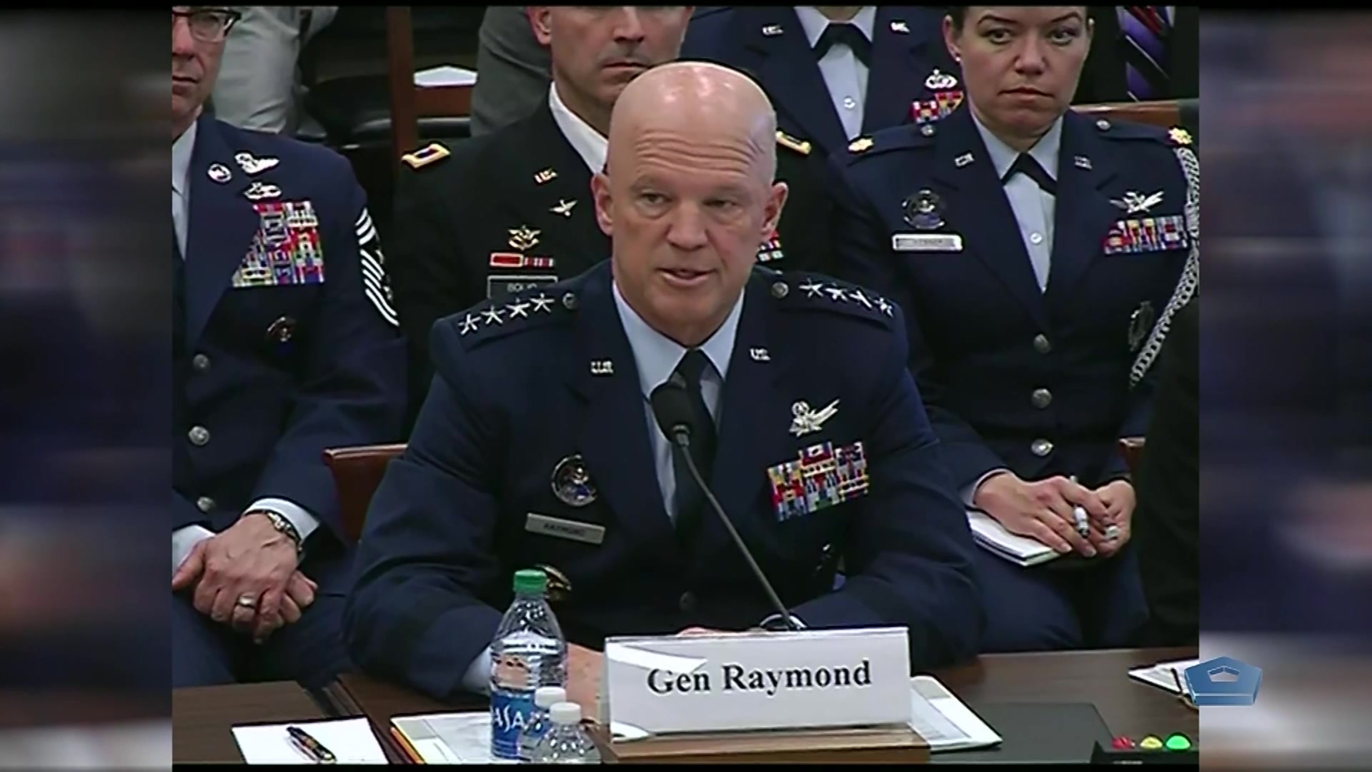 A Space Force general sits at a table and speaks.