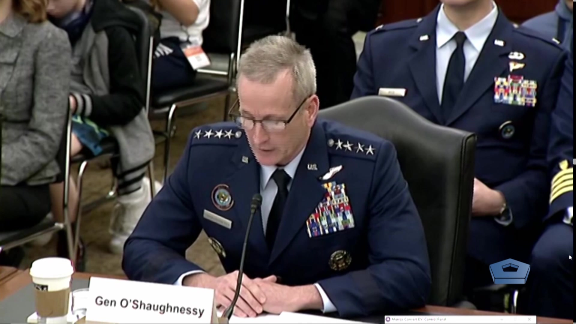 An Air Force general speaks at a table.