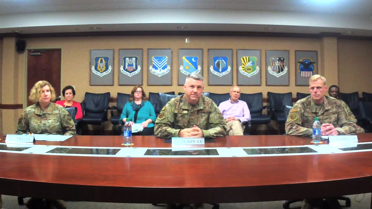Video thumbnail shows command team delivering Virtual Town Hall from their conference table.