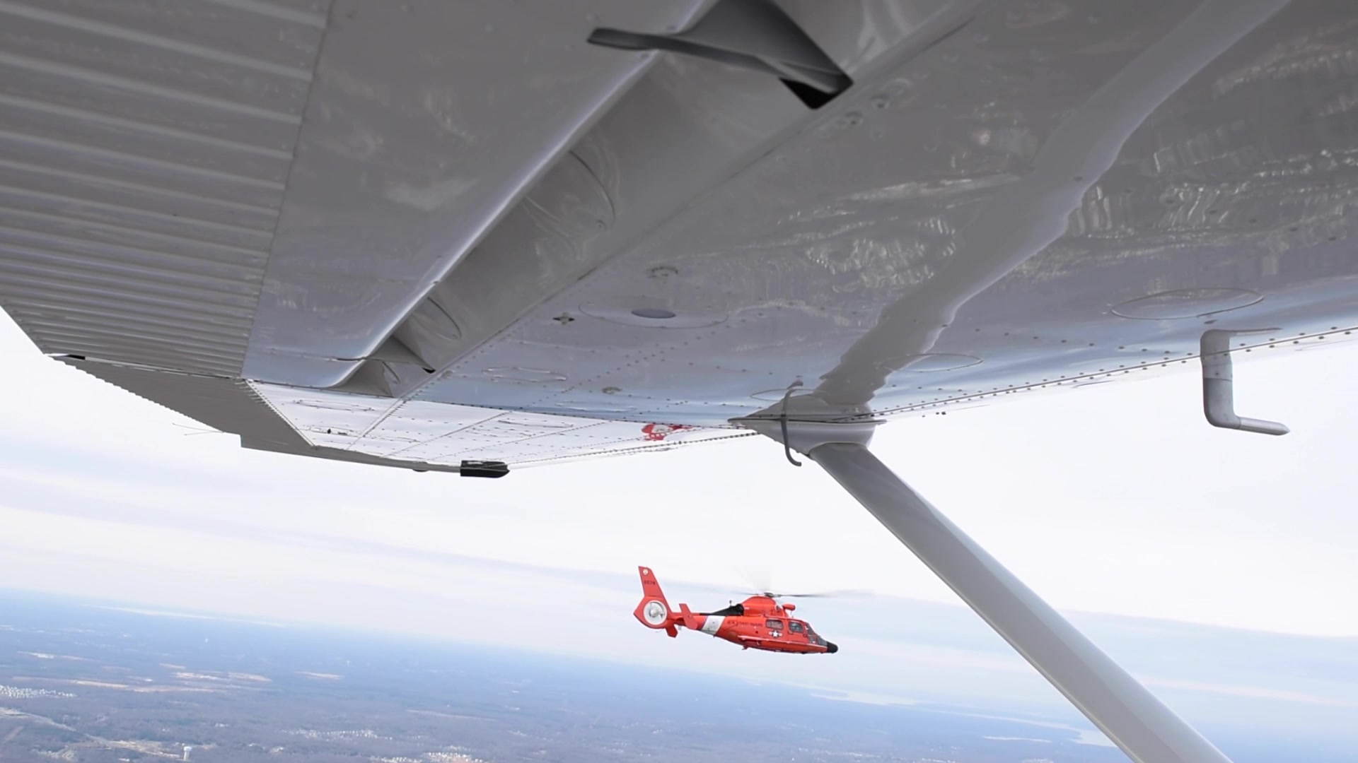 U.S. Coast Guard Blackjack aircrews aboard an MH-65 Dolphin helicopter, intercept Civil Air Patrol aircraft posing as a potential threat in restricted airspace in the Washington, D.C., area on March 11, 2020. The helicopters are used as a warning to ensure aircraft are aware of their intrusion in restricted airspace and need to change course. U.S. Coast Guard photo by Petty Officer 1st Class Andy Kendrick.