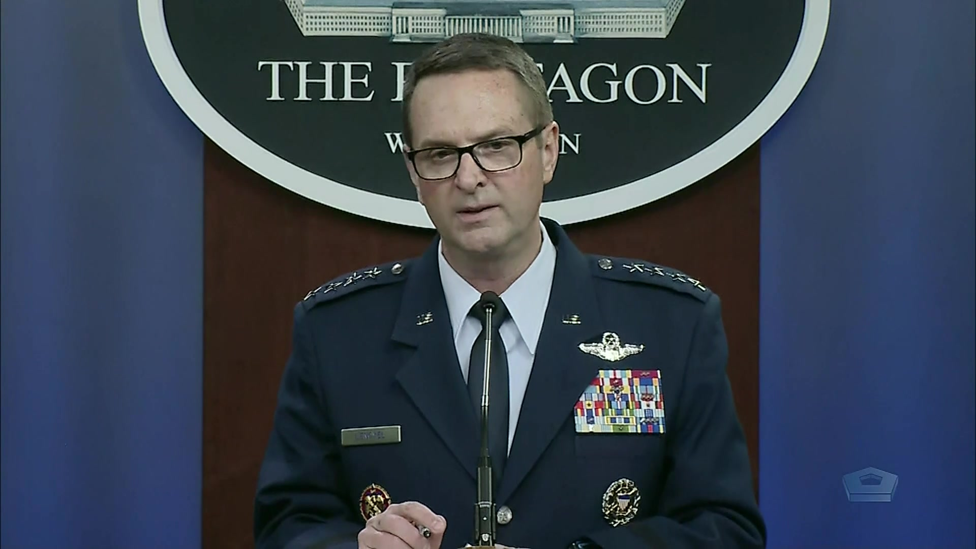 An Air Force general stands at a lectern.