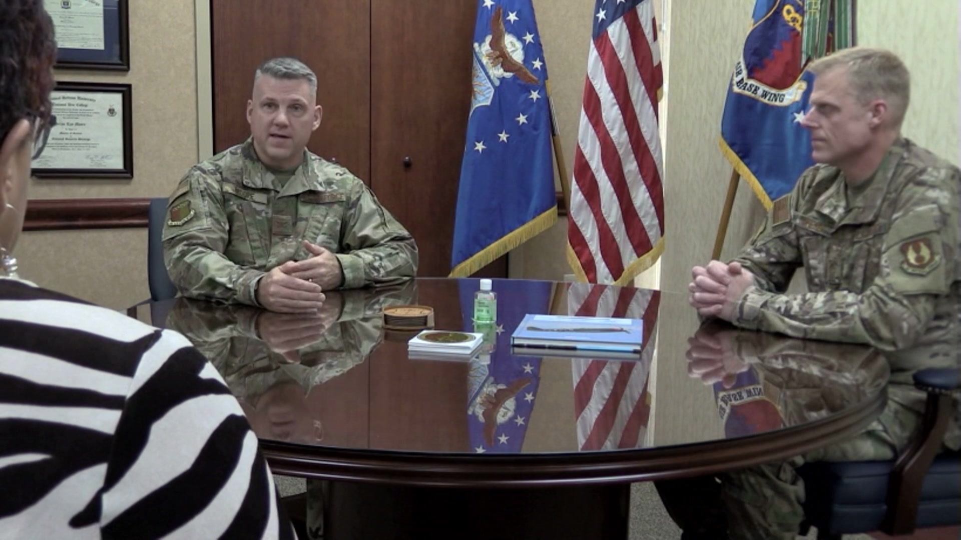 Video thumbnail shows Col. Brian Moore and Chief Master Sgt. Timothy Wieser sitting at a table answering questions from off camera.