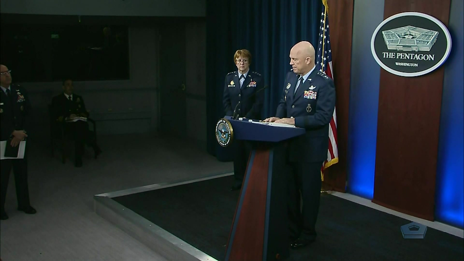 A Space Force general speaks at a lectern.