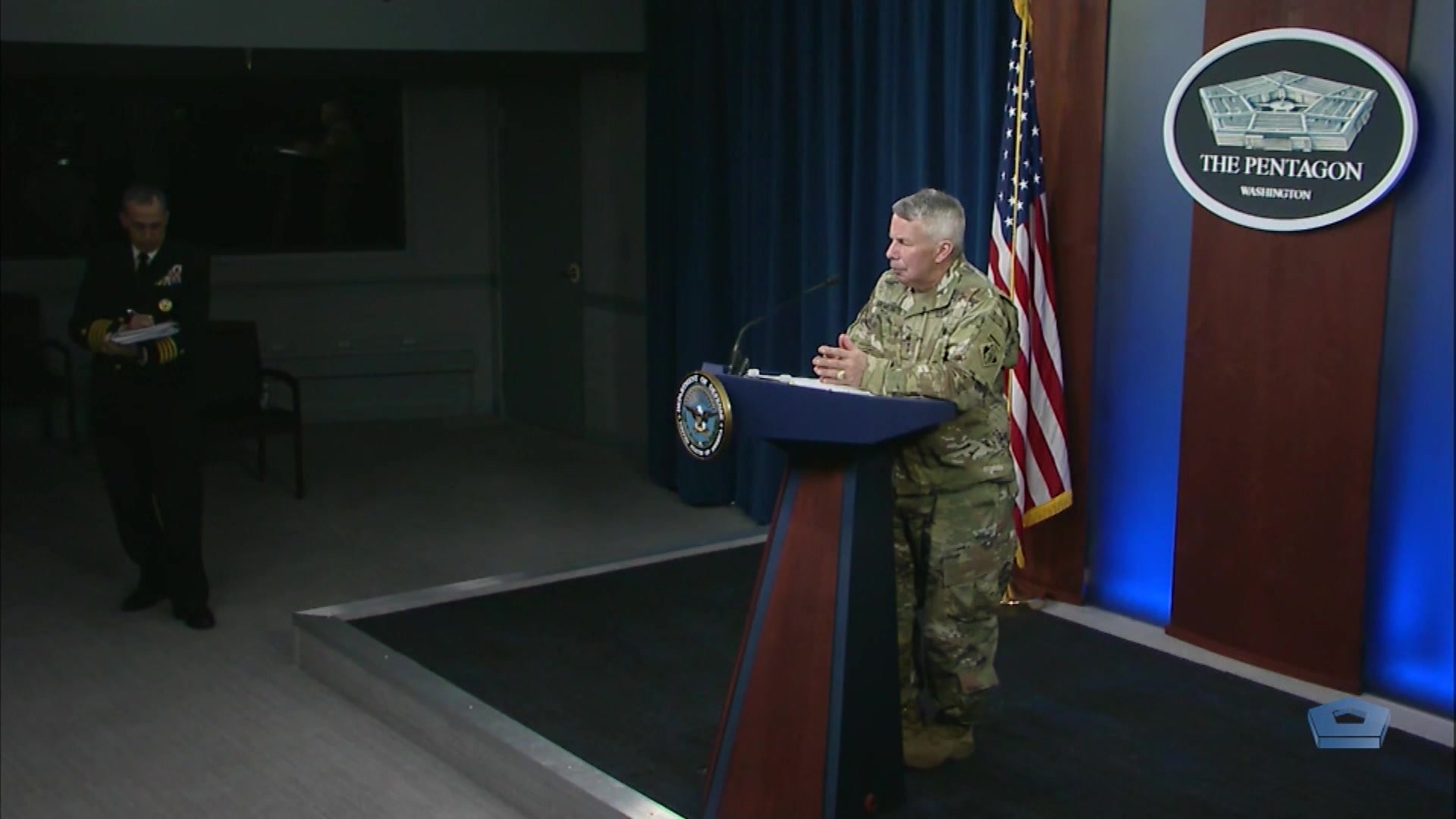 An Army general stands at a lectern.