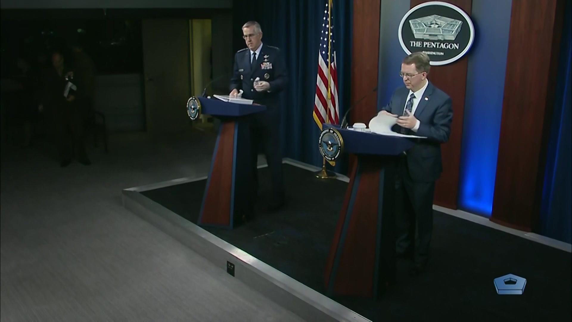 Deputy Defense Secretary David L. Norquist and Air Force Gen. John E. Hyten stand at lecterns.