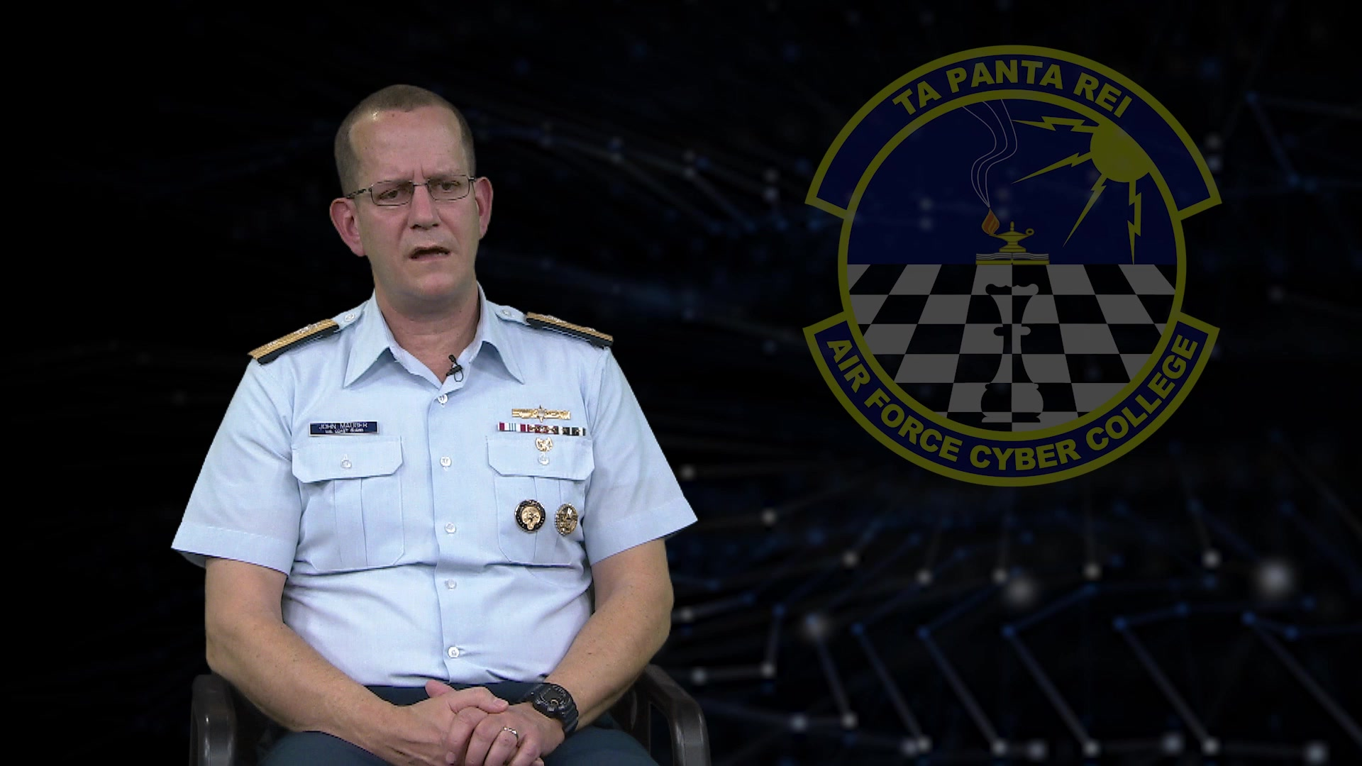 One-on-one interview with RDML John Mauger, US CYBERCOM led by Col Kevin Beeker, Air Force Cyber College discussing cyber training and the role of professional military education.