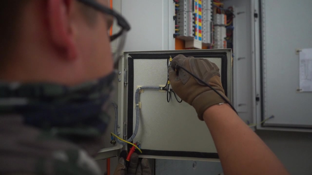 379 Expeditionary Civil Engineering Squadron electrical systems Airmen are responsible for electrical power to facilities and various other areas on Al Udeid Air Base, Qatar.
