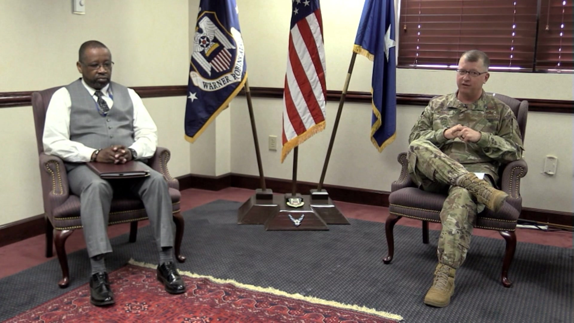 Video thumbnail shows Mr. Williams and Brig. Gen. Kubinec sitting in chairs speaking to the camera.