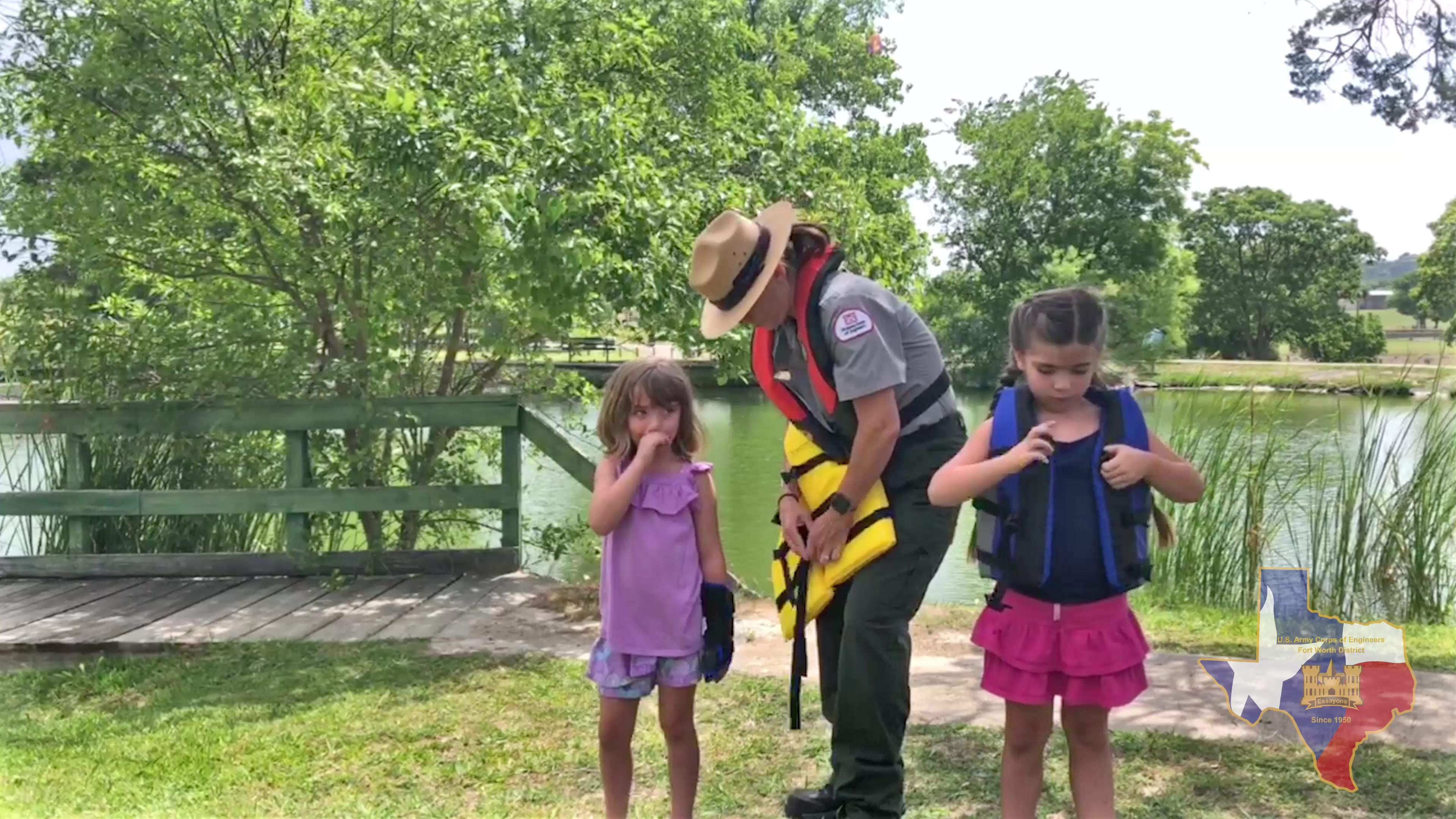 Learn how to inspect and properly fit a life jacket with Proctor Lake's Ranger Stephanie Jones and her two, too cute, guests.