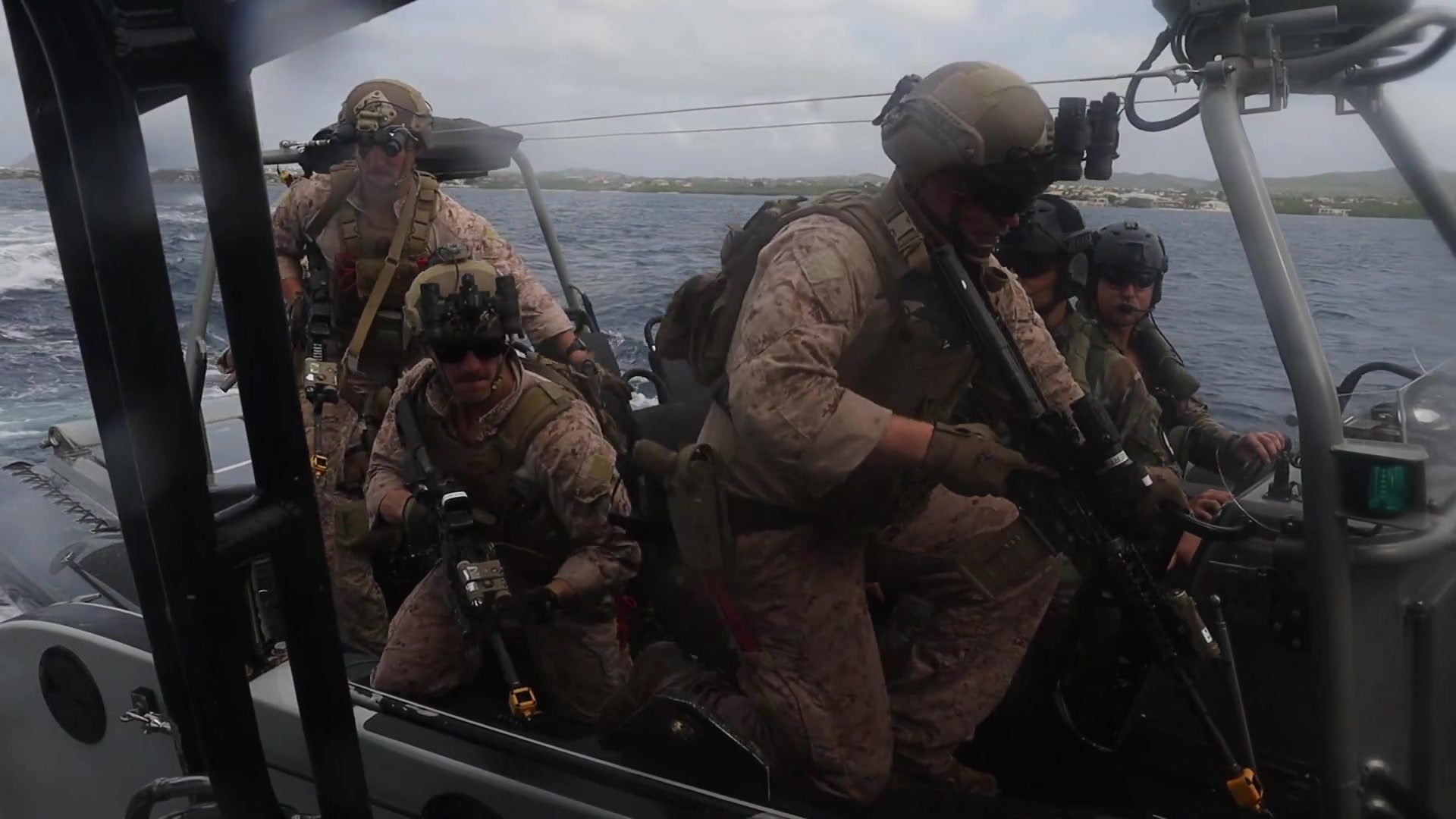 U.S. Marines with C Company, 2d Reconnaissance Battalion (Recon Bn.), 2d Marine Division (MARDIV) participate in visit, board, search, and seizure (VBSS) training with Netherlands Marines with the 32nd Raiding Squadron near Netherlands Marine Barracks Savaneta, Aruba, Nov. 13, 2020. VBSS skills are critical when fighting in littoral and coastal regions. 2d Recon Bn's mastery of these skills is paramount so they can integrate effectively with their naval counterparts to win the next major conflict. Being able to learn from the Dutch Marines in their primary area of operation helps 2d Recon Bn. build a faster, more mobile, and more lethal force when operating in diverse locations. (U.S. Marine Corps video by Lance Cpl. Brian Bolin Jr.)