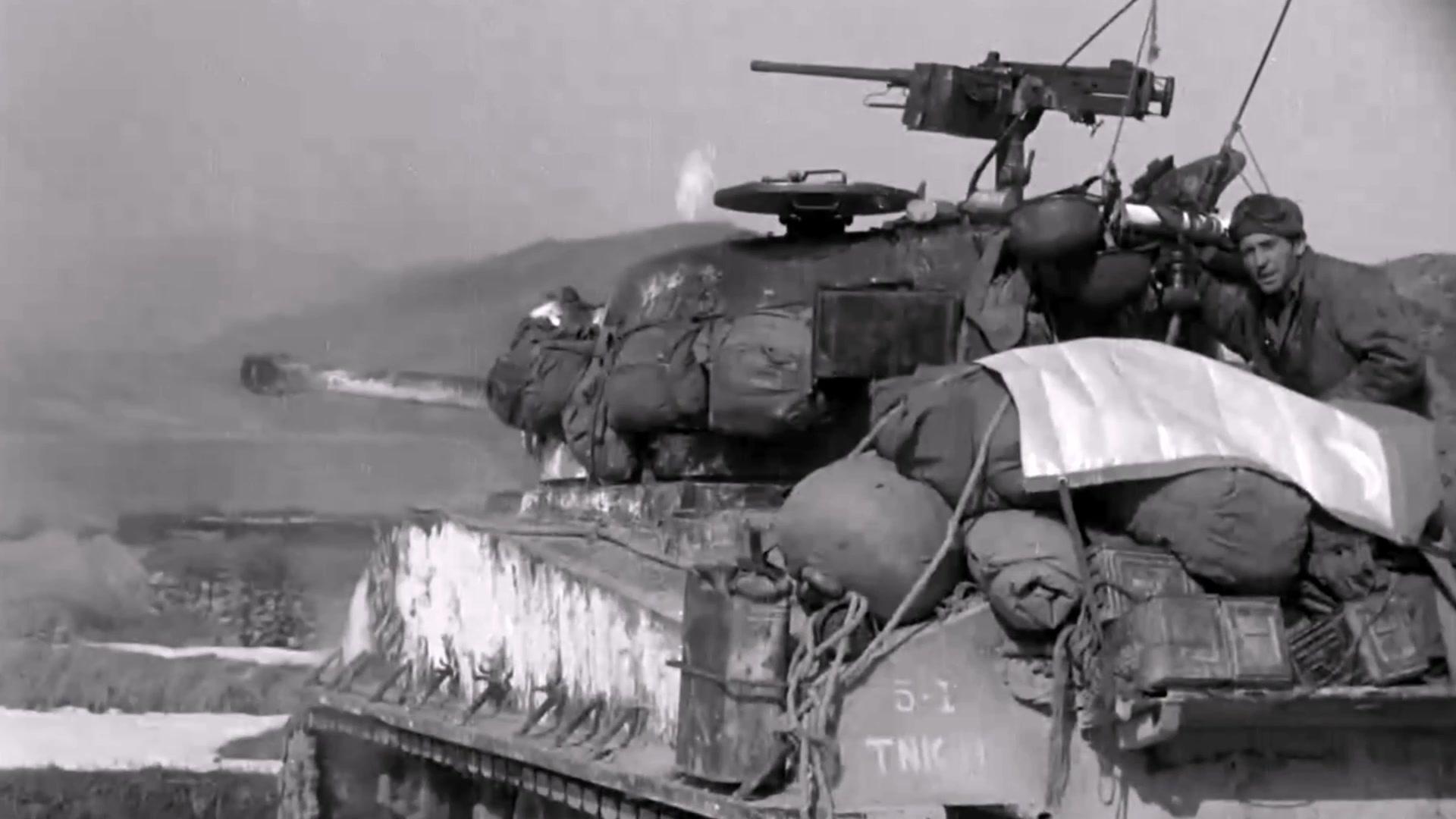 A service member sits in a tank.