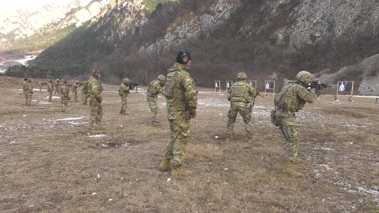 U.S. Army Paratrooper 1st. Sgt. Gerber Ryan J., assigned to Legion company, 1st Battalion (Airborne), 503rd Infantry Regiment, 173rd Airborne Brigade, talks cross training at Rivoli Bianchi range, Venzone, Italy, Jan. 20, 2021, under Covid-19 prevention conditions.  The 173rd Airborne Brigade is the U.S. Army Contingency Response Force in Europe, capable of projecting ready forces anywhere in the U.S. European, Africa or Central Commands' areas of responsibility (U.S. Army Video by Antonio Bedin)