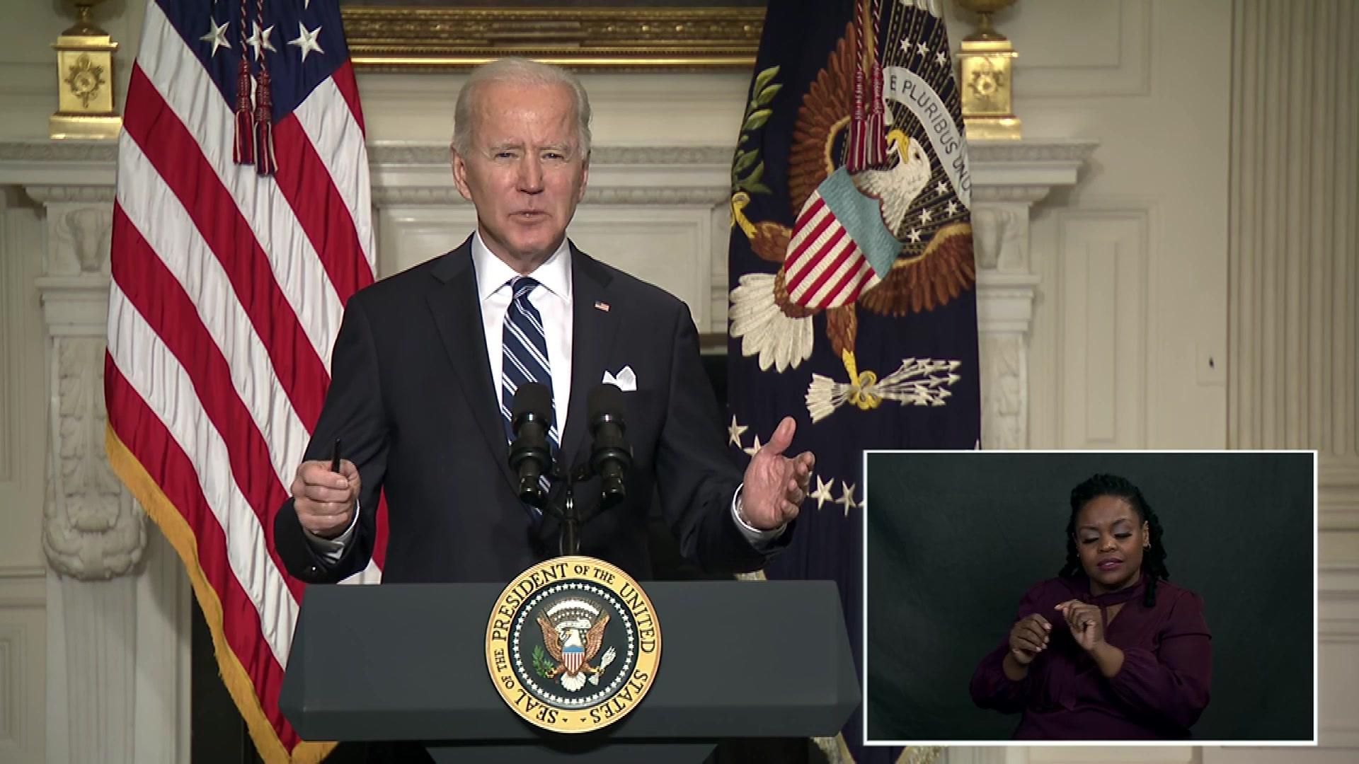 President Joe Biden speaks at a lectern.