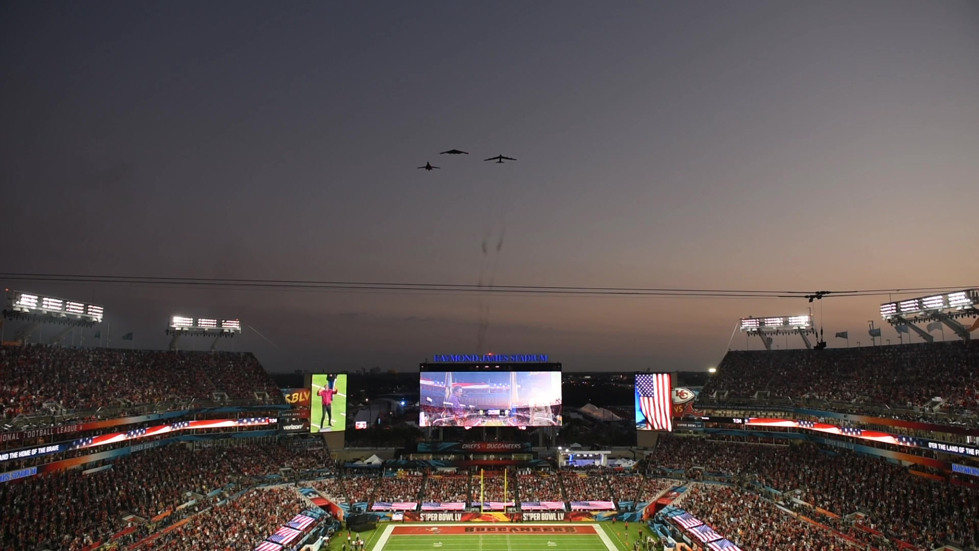 Air Force Global Strike Command bombers perform the Super Bowl LV flyover at Raymond James Stadium in Tampa, Fla., Jan. 7, 2021. The trifecta was the first of its kind as it included a B-1B Lancer from Ellsworth Air Force Base, S.D., a B-2 Spirit from Whiteman AFB, Mo., and a B-52H Stratofortress from Minot AFB, N.D. (U.S. Air Force video by Tech. Sgt. Jensen Stidham)