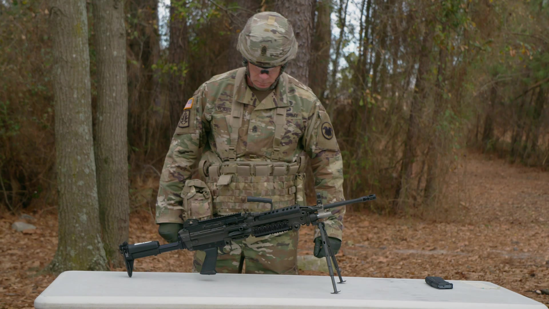 Cmd. Sgt. Maj. Andrew Lombardo, U.S. Army Reserve command sergeant major, demonstrates the Expert Soldier Badge tasks for the M249 machine gun.