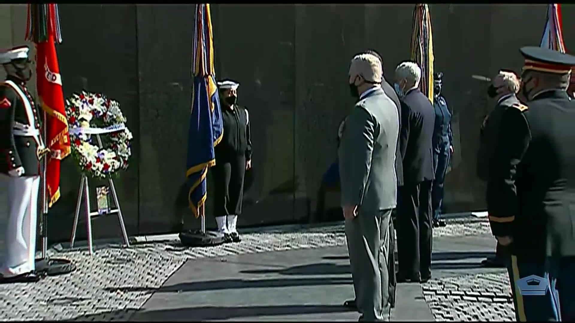 Secretary of Defense Lloyd J. Austin III and Secretary of Veterans Affairs Denis R. McDonough honor Vietnam War veterans during a wreath-laying ceremony at the Vietnam Veterans Memorial in Washington, March 29, 2021.