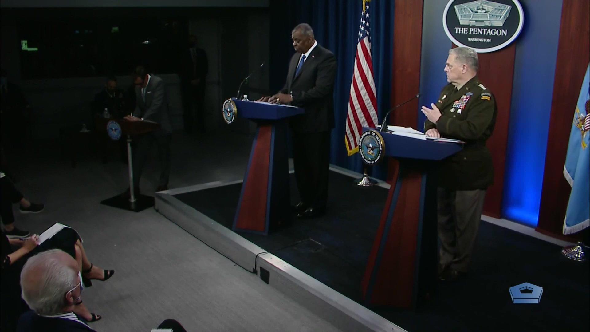 Secretary of Defense Lloyd J. Austin III speaks at a lectern.