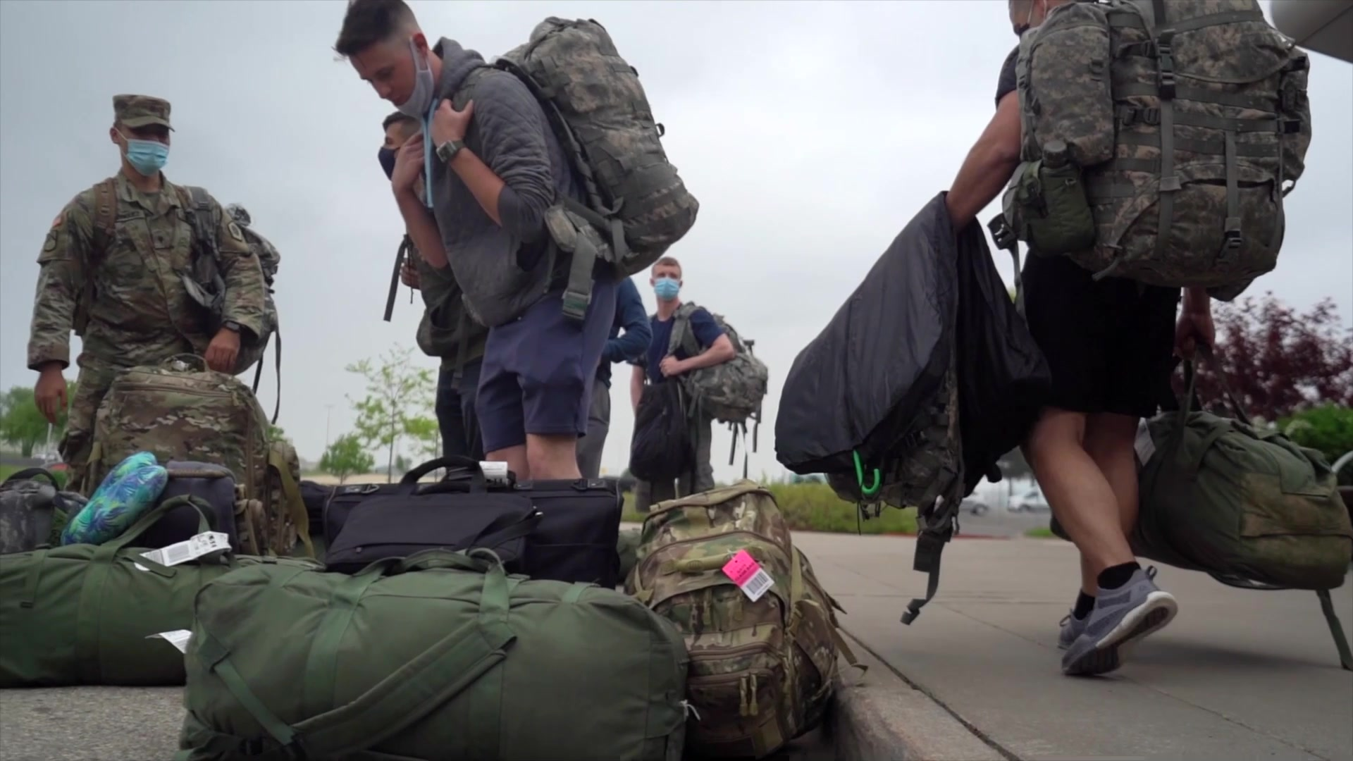 """U.S. Army Reserve Soldiers, arriving at La Crosse Regional Airport during the 2021 U.S. Army Reserve Best Warrior Competition at Fort McCoy, Wisconsin, May, 19. Approximately 80 Soldiers from across the nation traveled to Fort McCoy, Wisconsin, to compete in the event that runs from May 19-27, 2021. The 2021 BWC is an annually-recurring competition that brings in the best Soldiers from across the U.S. Army Reserve to earn the title of """"Best Warrior"""" among their peers. Competitors are evaluated on their individual ability to adapt and overcome to challenging scenarios and battle-focused events, which test their technical and tactical abilities under stress and extreme fatigue. (U.S. Army Reserve photo by SGT PHILIP RIBAS)"""