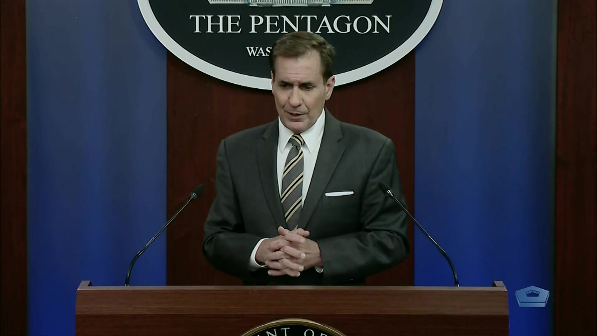 Pentagon press secretary speaks at a lectern.