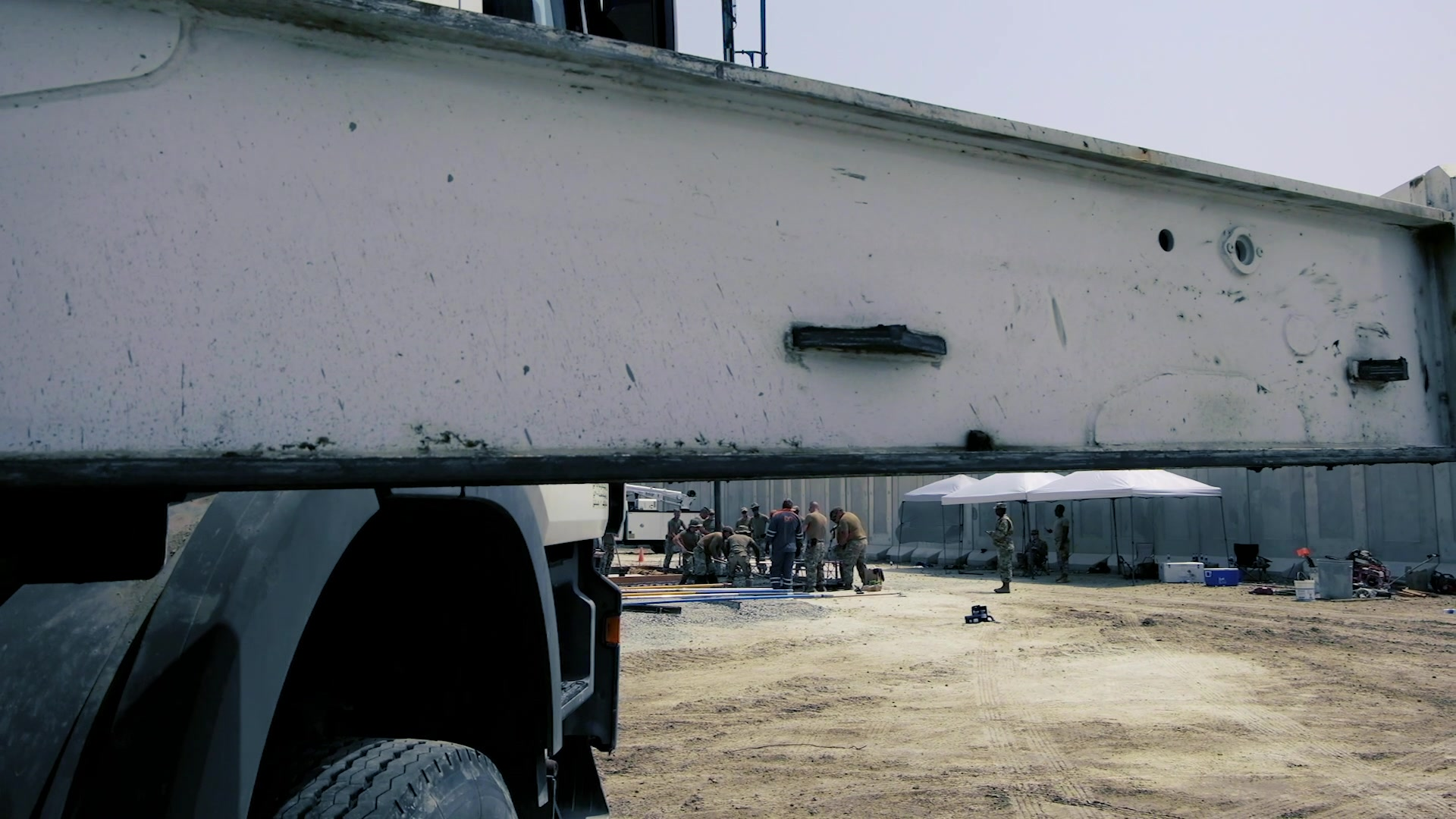 Dirt Boyz of the 380th Expeditionary Civil Engineer Squadron and the 1st  Expeditionary Civil Engineer Group work together constructing a slab of concrete that is a part of the beginning stages of a lodging expansion project at Al Dhafra Air Base, United Arab Emirates.