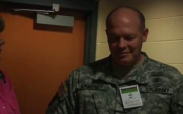 National Guard officer honored with ceremonial first pitch