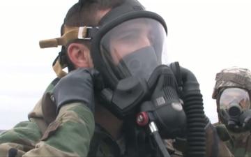 Airmen Operate Fire Truck in Gas Masks