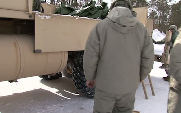 Michigan National Guard conducts cold weather sling load and howitzer live fire exercise
