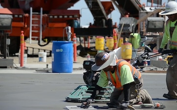 Workers top-off the mass concrete for the Folsom auxiliary