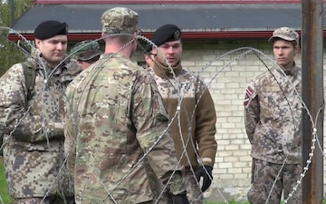 Michigan and Latvian Soldiers Demonstrate Military Equipment