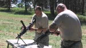 235th Military Police Company assembling weapons