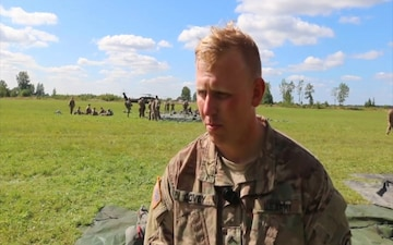 U.S. and Estonian Soldiers Perform Joint Helicopter Jump
